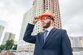Engineer Builder Wearing Suit And Helmet At Construction Site poster