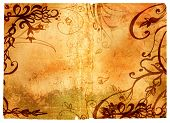 Grunge page with rich texture and dark floral swirls border, clipping path for edge is incl