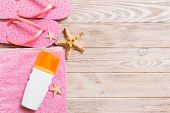 Top View Of Beach Flat Lay Accessories. Sunscreen Bottle With Seashells, Starfish, Towel And Flip-fl poster
