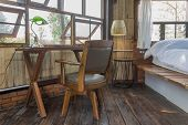 Arm Chair And Table In Bedroom Of Interior Design Room. Interior Design Room Include Lamp And Window poster