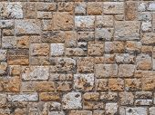 Old Beige Stone Wall Background Texture Close Up. Texture Of A Stone Wall. Old Castle Stone Wall Tex poster