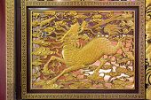 picture of chinese unicorn  - Gold Gilt Wood Carving of Qilin on Chinese Temple Wall in Chinatown - JPG