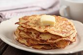 Stack of cornmeal pancakes with a cube of butter