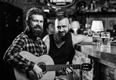 Real Men Leisure. Hipster Brutal Bearded Spend Leisure With Friend In Bar. Man Play Guitar In Bar. C poster