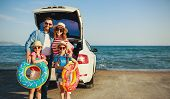 Happy   Family Mother Father And Children In Summer Auto Journey Travel By Car On Beach poster