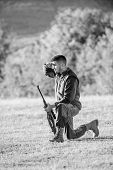 Hunter With Rifle Looking For Animal. Hunting As Male Hobby And Leisure. Man Charging Hunting Rifle. poster