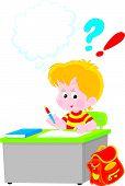 Schoolboy writing a test in school