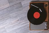 Turntable Vinyl Record Player On The Background Of Their Gray Wooden Boards. Needle On A Vinyl Recor poster