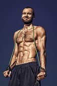 Stretching Exercise Concept. Training Motivation. Stretch Muscles. Man Sexy Muscular Bare Torso Outd poster