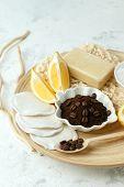 Ingredients For Prepare Homemade Coffee Scrub. Coffee Grains, Sea Salt, Soap, Lemon On Wooden Plate  poster