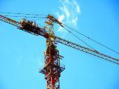 Self-erecting Tower Crane. Construction Crane Against Cloudy Sky. Construction Site. poster