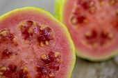 Sliced ​​guava On Wooden Surface In Macro Photography. Typical Brazilian Fruit Used In Vitamins And poster