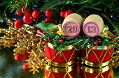 an image of wooden bingo kegs with numbers of coming new year