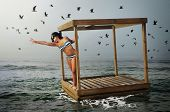 Conceptual image with a cubical raft adrift in the ocean and a girl with stretched arm