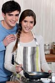 stock photo of concubine  - Couple cooking together - JPG