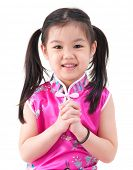 Chinese young girl in traditional Chinese cheongsam blessing, isolated on white background