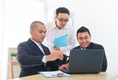 pic of ebusiness  - Southeast Asian business team discuss in office - JPG