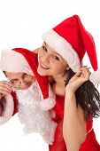 image of promiscuous  - Portrait of Santa Claus with sexy girl in Santa hat - JPG