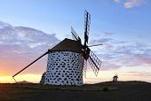 Two old windmills near La Oliva in the sunset