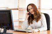 Beautiful Businesswoman Talking By Phone