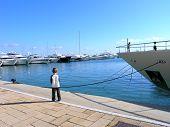 Boy In A Marina