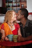 Mixed Eskimo Kiss In Cafe