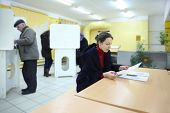 MOSCOW - DECEMBER 4: People casting ballots on elections to State Duma of Russian Federation on Dece