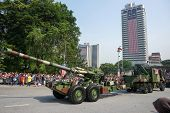 KUALA LUMPUR - AUGUST 31: Cannons from the artillery units take to the city streets in a parade as M
