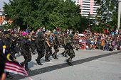 KUALA LUMPUR - AUGUST 31: Commandoes from Army, Navy, Air Force and Police  march together on the ci