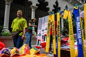 KUALA LUMPUR - AUGUST 31: A street vendor sells scarfs and other Malaysian memorabilia celebrating M