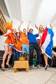 Dutch Sports fans cheer ecstatically over a goal and victory of the national team of the Netherlands