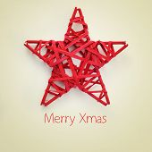 stock photo of star shape  - a red christmas star and the sentence merry xmas on a beige background - JPG