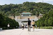 TAIPEI, TAIWAN - SEPTEMBER 4 : Many tourist people walk toward Taipei's National Palace Museum on September 4, 2013 in Taipei, Taiwan, Asia.