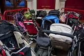 foto of teen pregnancy  - Group of prams or strollers outside theater - JPG