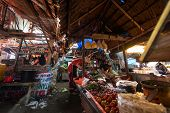 PADANG - AUGUST 25: Traders work at their stalls sell local farm produce at a village market in Padang, Sumatera, Indonesia on August 25, 2013. Agriculture and fishery is an important industry here.