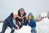 Family make a snowman