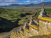 Wall With Stupas And Distant Town