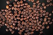 Fresh Roasted Coffee Beans On Black Background