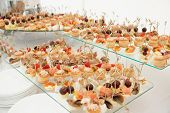 foto of picking tray  - Various snacks on full boarded banquet table - JPG