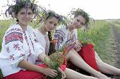 Three Ukrainian girls in national costumes