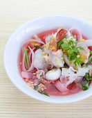 rice noodles in pink soup, thai cuisine