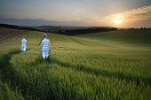 Concept Landscape Young Boys Walking Through Field At Sunset In Summer