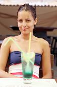 Beautiful young girl with coctail.