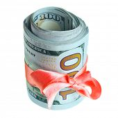 Roll of new hundred dollar bills with ribbon and bow