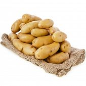 Raw potatoes heap with sack cloth isolated on a white background