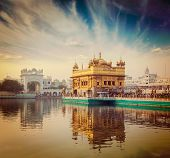 Vintage retro hipster style travel image of famous India attraction Sikh gurdwara Golden Temple (Harmandir Sahib). Amritsar, Punjab, India