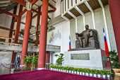 TAIPEI, TAIWAN - JANUARY 16, 2013: A soldier stands guard over Chiang-kai Shek Memorial Hall. He fir