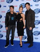 LOS ANGELES - FEB 20:  Keith Urban, Jennifer Lopez & Harry Connick Jr. arrives to the American Idol