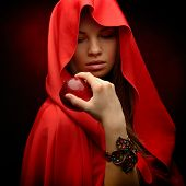 beautiful woman with red cloak hoding red apple