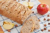 stock photo of home-made bread  - Home made Apple Hazelnut Bread on a table